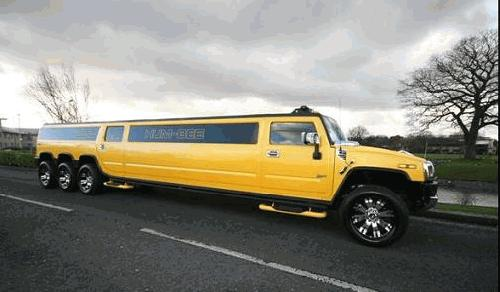 Chauffeur stretched yellow 8-wheeler triple axle H2 hummer limo in Manchester, Liverpool, Cheshire, Chester, Stockport, North West, Blackburn, Preston, Bolton, Wigan, Lancashire.