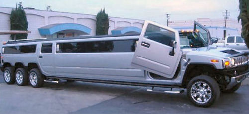 Chauffeur stretched silver 8 wheeler Hummer H2 limousine hire in Nottingham, Derby, Leicester, Birmingham Leeds, Bradford, Nottinghamshire, Derbyshire, West Yorkshire, South Yorkshire Midlands.