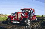 Chauffeur driven red Beauford wedding limousine in Scotland, Glasgow, Dundee, Edinburgh, Lanarkshire, Motherwell, Paisley, East Kilbride, Kilmarnock, Coatbridge, Greenock, Hamilton and Perth.
