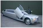 Chauffeur stretch silver Chrysler C300 Baby Bentley limousine hire with Lamborghini doors in Nottingham, Derby, Leicester, Birmingham, Nottinghamshire, Derbyshire, Midlands.