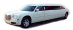 Chauffeur stretched white Chrysler C300 Baby Bentley limo hire in UK.