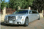 Chauffeur stretch silver Chrysler C300 Baby Bentley limo hire in Sheffield, Rotherham, Doncaster, Chesterfield, South Yorkshire.