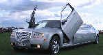 Chauffeur stretch silver Chrysler C300 Baby Bentley limousine hire with Lamborghini doors in Leeds, Bradford, Huddersfield, West Yorkshire.